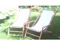 Two wooden deck/beach chairs traditional style with armrests