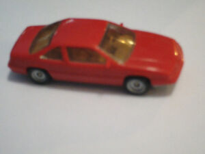 HO scale Red Ford Thunderbird car for model trains