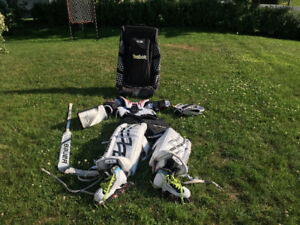 Hockey goalie gear with bag and stick