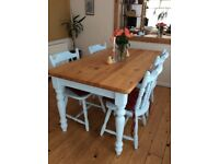 Shabby chic clunky pine dining table and chairs for sale.