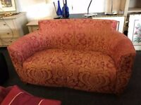 sofa in orange and gold swirl pattern