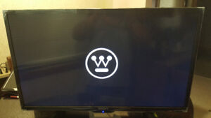 40 inch Westinghouse Smart LCD TV + remote for parts or repair.