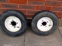 A Pair of Trailer Wheels and Tyres