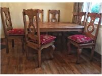 Table 6 chairs with cushions , plus sideboard . Rustic style.