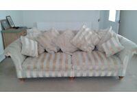 3 seater fabric cream and gold sofa.