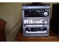 AIWA Silver hifi System, 2 Speakers, CD, Radio, Double Cassette for recording and playing.