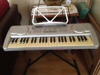 Acoustic solutions keyboard with music stand, keyboard stand, and mains plug. Good working order.