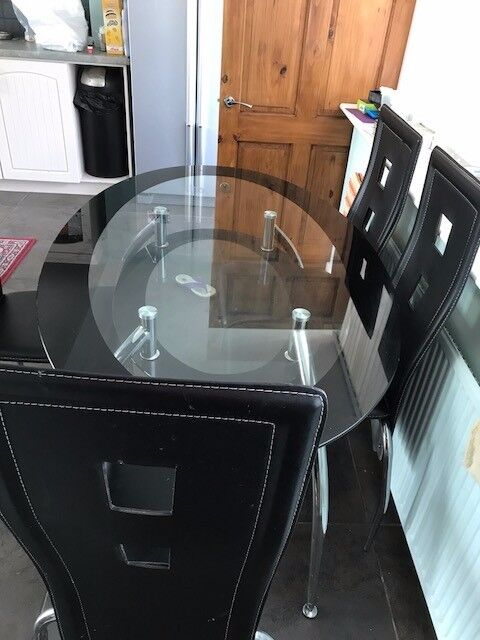 Oval 2 Tier Glass Dining Table And 4 Chairs