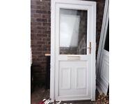 Upvc white half glazed door with low Aluminium threshold.