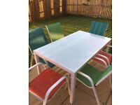 Janiero Patio Dining Set: Glass topped table and six chairs