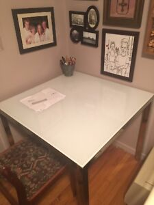 Square glass and chrome desk space