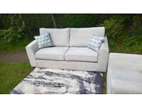 Designer 3 Seater Silver Fabric Sofa and Matching Arm Chair.