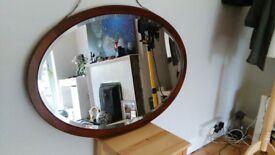 Vintage Oval mahogany bevel edged mirror