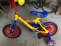 """Child's 12"""" first bike with stabilisers"""