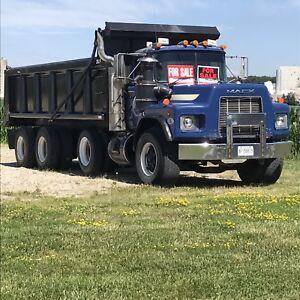 Tri axle dump truck.