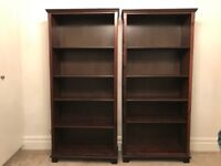 Two dark wood bookcases £40 for both