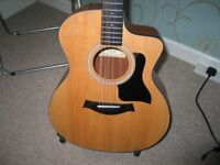 TAYLOR 114 ce 100 SERIES SAPELE GRAND AUDITORIUM CUTAWAY ELECTRO ACOUSTIC GUITAR. 1 YEAR OLD.