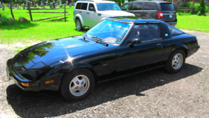 1981 Mazda RX7 GSL. Southern car, trade for snowmobile