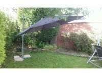 Large garden parasol sun hanging umbrella.