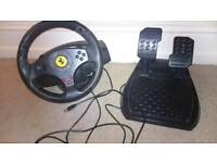 PC thrustmaster gaming wheel and gears.