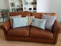 Tan real leather sofabed