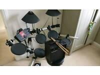 Yamaha dtxplorer with drum chair.