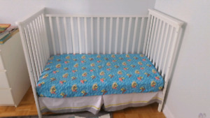 White baby crib or toddler bed
