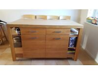 Beech kitchen island unit with breakfast bar.