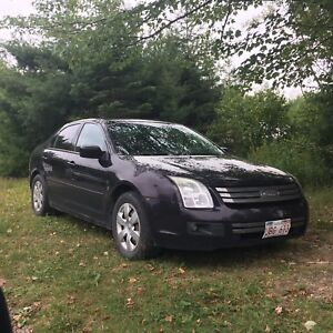 Trade: 2007 Ford Fusion for Snowmobile