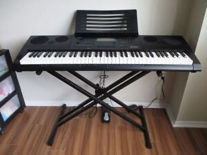 Casio 61-Key High-Grade Keyboard piano & stand & pedal sound amp