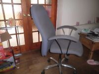 Large, blue office type chair with high back and arms. Lift and lower as well as tilt.