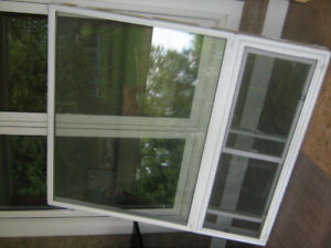 Picture window with slider below. White vinyl, in good shape.