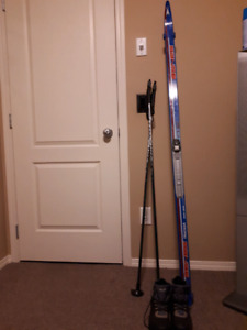 Skies, poles, boots, bindings for sale.
