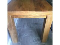 Solid wood dining table & 4 sea grass chairs from Oak Furniture Land. V good condition.
