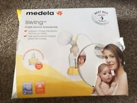Medela swing single electric breastpump with breastpads, creams, nipple shields...