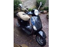 Piaggio Vespa LX50 - low mileage - with Tucano Urbano cover worth £50, Gran Turismo helmet and lock