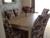 Dining table ,6 chairs and unit.
