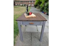 Vintage rustic farmhouse kitchen/dining table. Warm grey shabby chic.