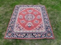 Next Rug in new condition with traditional symmetrical pattern. size 120cm x 165cm