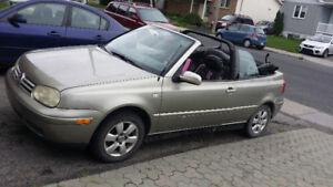 Volks cabriolet 2001 full cuir ac excellente condition