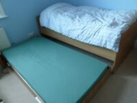 Single bed with second roll-under guest bed
