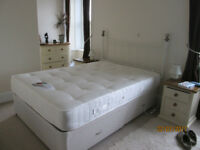 Double bed with mattress, headboard and storage