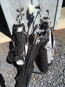 3 sets of junior golf clubs and bags