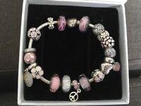 Genuine Pandora bracelet and 19 charms pink/white 21cm