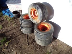 5 Golf Cart Wheels and Tires great condition.