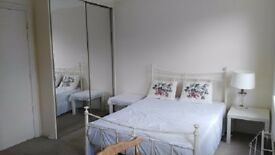 a lovely double room in the house(close wimbledon station )