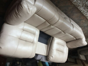 LEATHER RECLINING COUCH --- FLOOR MODEL $299
