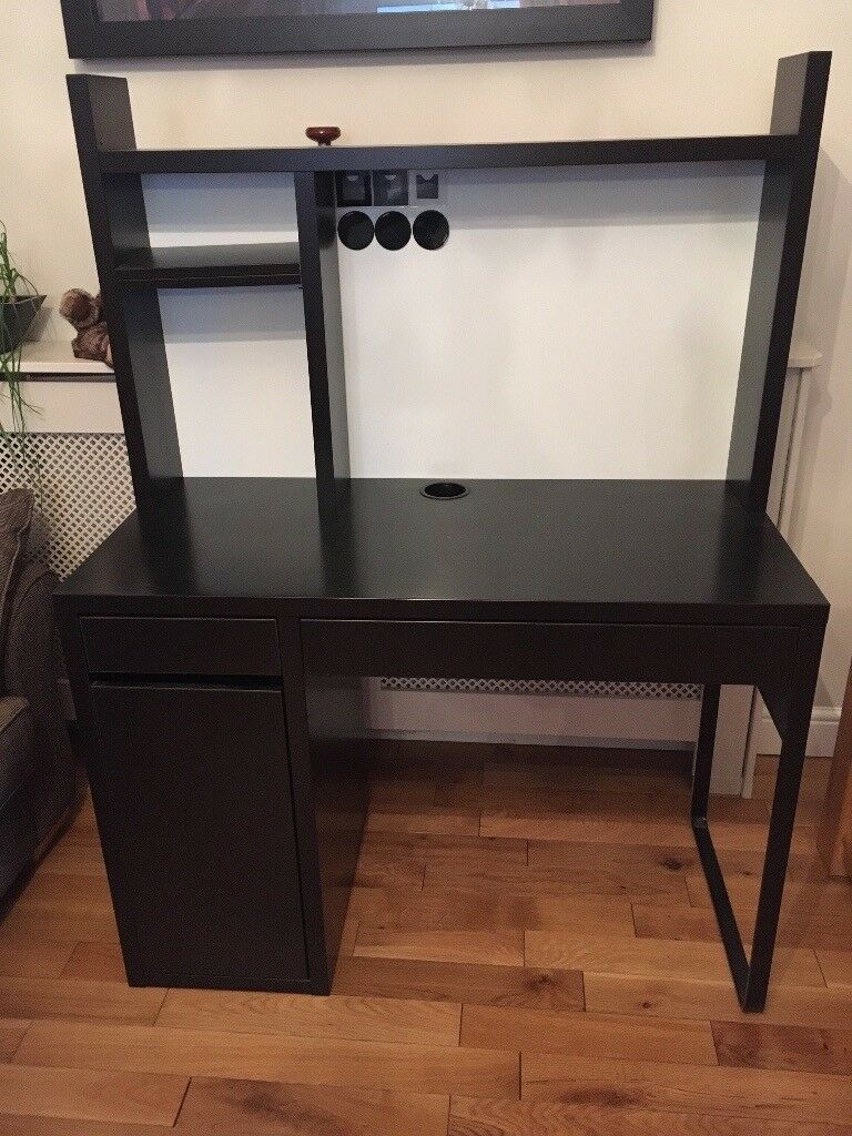 IKEA desk (black brown) with attaching top unitin Chislehurst, LondonGumtree - IKEA Micke desk unit in black brown. Comprises the desk with a drawer unit down the left hand side (one pull out top drawer and a cupboard beneath with three shelves) and a drawer along the length of the rest of the desk as visible in the photos....