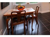 Walnut dining table with two extending leaves and 4 chairs, great for kitchen or dining room