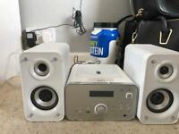 White stereo with speakers.